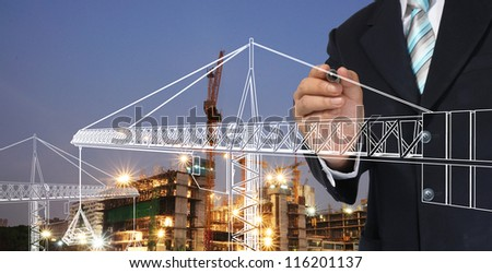 Business man drawing tower crane