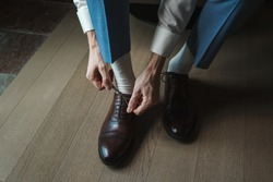 Business man dressing up with classic, elegant shoes. Groom wearing