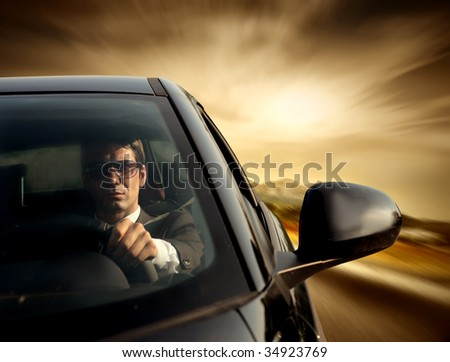 business man driving a car