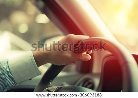 Business man driving car. Vintage filter.