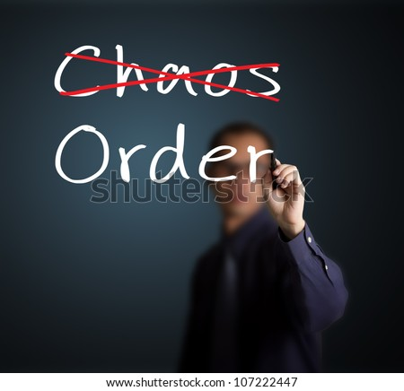 business man eliminate chaos and make order - stock photo