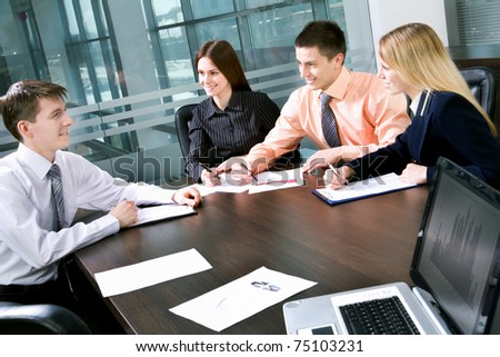 Business man explaining a new project to colleagues - stock photo