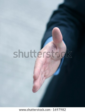 Business man extends hand - stock photo