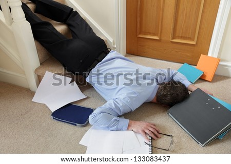Business man falling down the stairs in the office concept for accident and insurance injury claim at work Stock photo ©