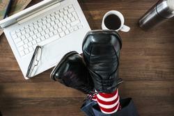 business man feet on desk taking break sleeping