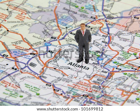 Business man figure standing on a map of Atlanta Georgia, USA.