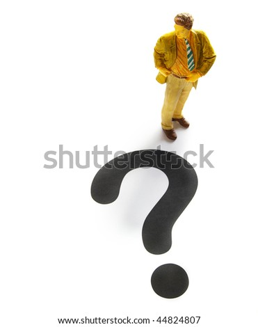 business man figure with a large question mark - stock photo
