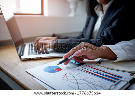 Business man financial inspector and secretary making report, calculating or checking balance. Internal Revenue Service inspector checking document. Audit concept Stock foto ©