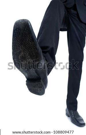 Business man foot trample closeup
