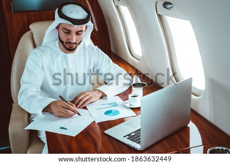 Business man from united arab emirates flying on his private jet to Dubai stock photo