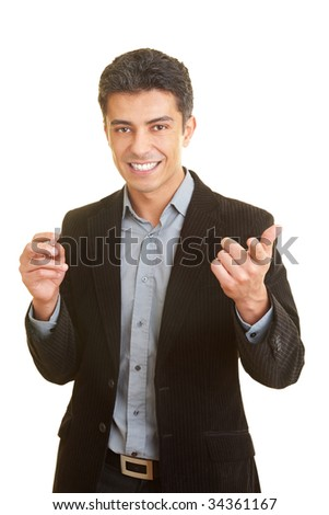 Business man gesticulating while holding a speech