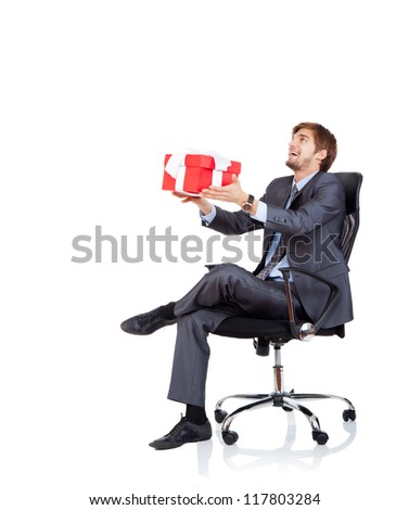 Business man give gift box in chair to side up corner empty copy space, businessman give red present, sitting in armchair, happy smile, Isolated over white background