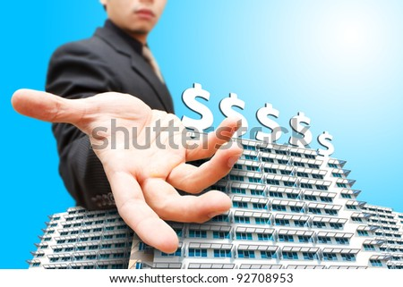 Business man give the hand on building and money icon