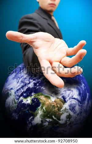 Business man give the hand to Earth
