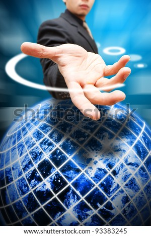 Business man give the hand to globe
