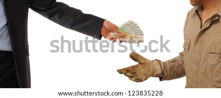 Business man gives money to a worker in gloves - stock photo