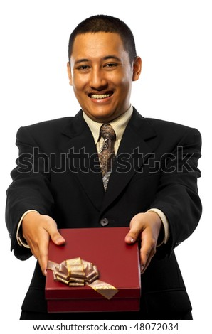 Business man giving a gift isolated on white background