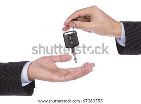 Business man giving a new key car to another man