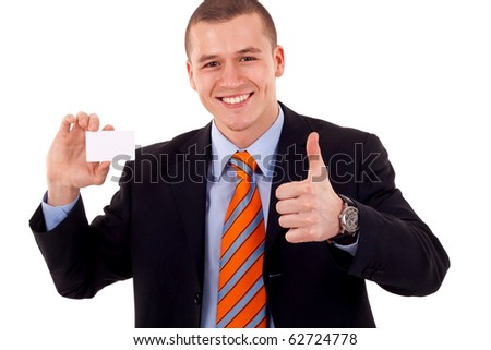 Business man giving thumbs up for the card he is holding