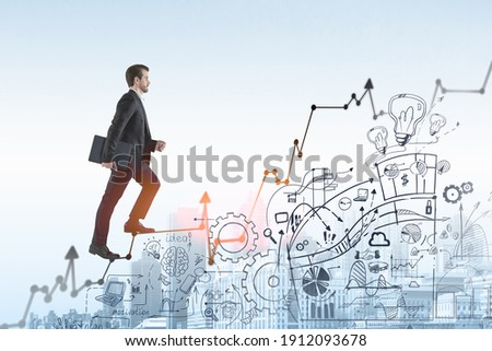 Business man go walk making step, businessman wear elegant black suit going up the stairs over ideas and concepts to built successful international business. business icons are drawn below the stairs Stock photo ©