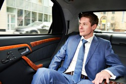 Business man goes to the executive car
