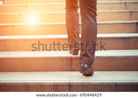 Business man going up the stairs  in a rush hour to work. Hurry time. Сток-фото ©