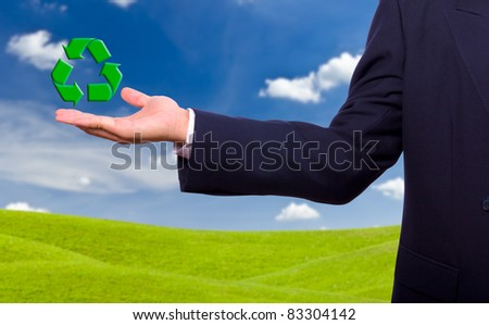 business man hand and recycle sign for green world concept