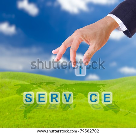 business man hand and service word on green grass meadow