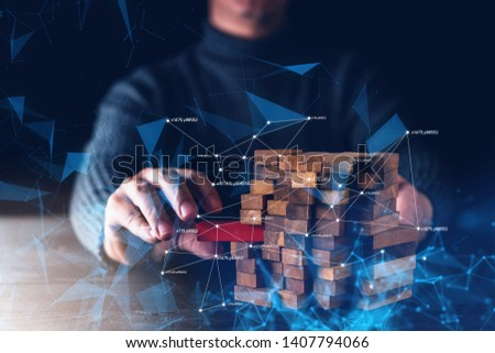 business man hand built structure wood block with virtual line connecting strategy vision plan business ideas concept #1407794066