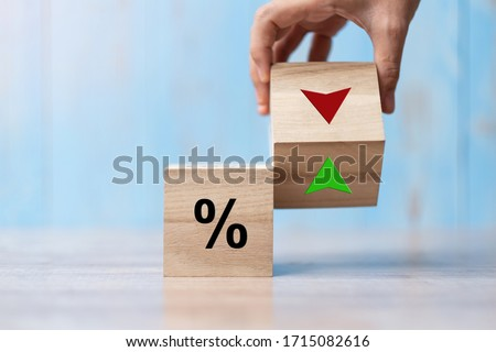 business man Hand change wood cube block with percentage to UP and Down arrow symbol icon. Interest rate, stocks, financial, ranking, mortgage rates and Cut loss concept Foto stock ©