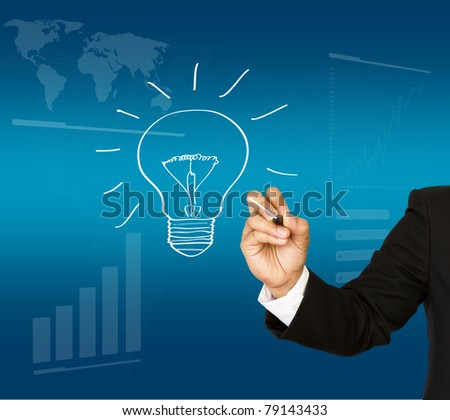 Business man hand drawing light bulb