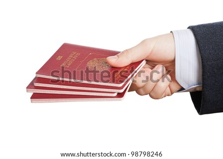 Business man hand holding international passport ID document for person identification