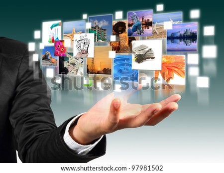 Business man hand holding with  industry image and buildings image flyer