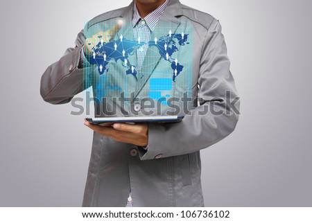 business man hand point to virtual business network process diagram, with on a tablet pc