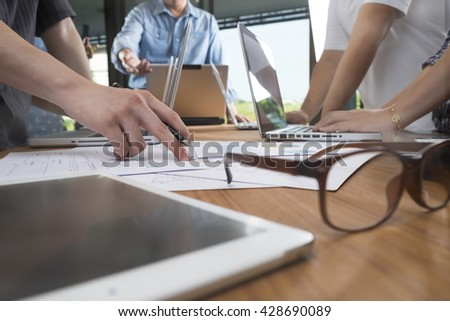 Business man hand pointing at business document during discussion at meeting #428690089