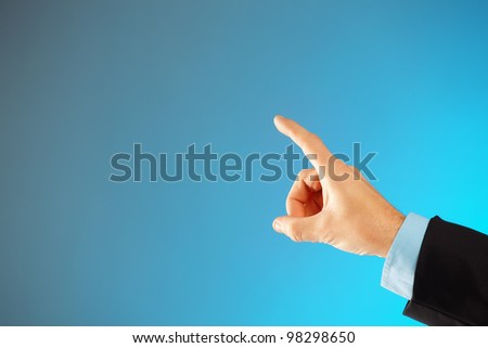 Business man hand pointing at something or selecting, you can easily add your text because of huge copy space