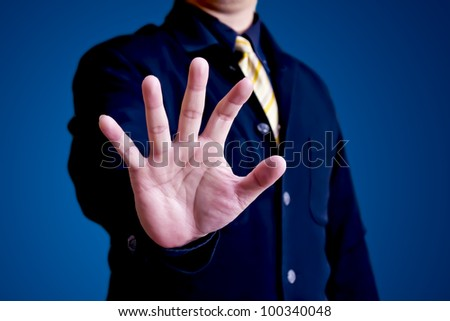 Business man hand reaching for something