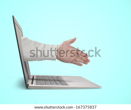 Business man hand reaching out from screen to shake with,  in green background
