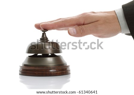 Business man hand ringing the bell for assistance