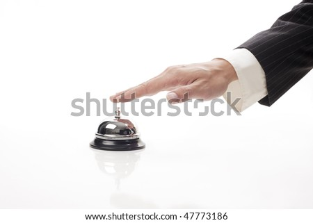 business man hand ringing the bell to call