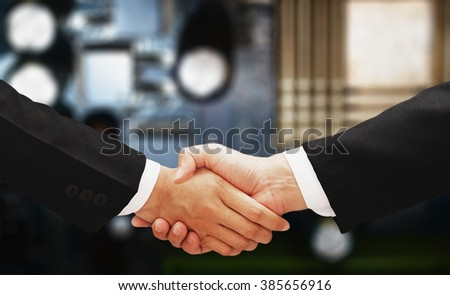 business man hand shake with...
