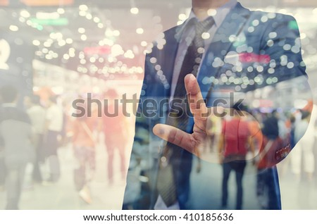 business man hand touching virtual screen on blurred people background #410185636