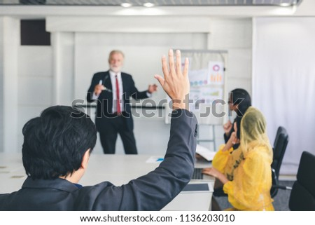 Business man hand up for asking questions in meeting, business training class concept