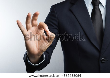Business man hand with ok sign on white background