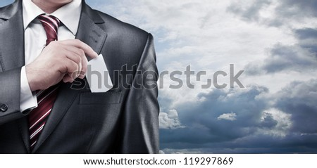 Business man handing a blank business card on the sky background