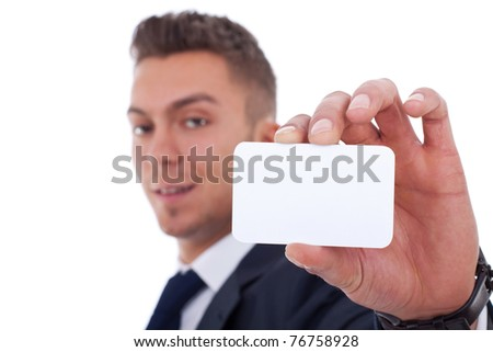 Business man handing a blank business card over white background, focus on hand and card