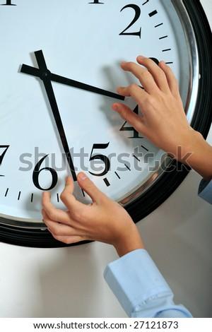 Business man hands manipulating hands of clock