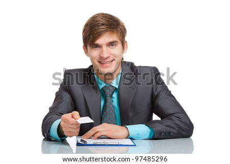 Business man happy smile holding a blank business card, give visiting, credit card, dressed in elegant suit, shirt and tie, Sitting at the office desk isolated over white background, Meeting concept