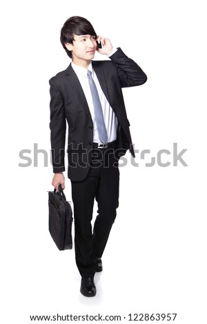 Business man happy Walking forward while talking on the mobile phone in full length isolated over white background, asian model