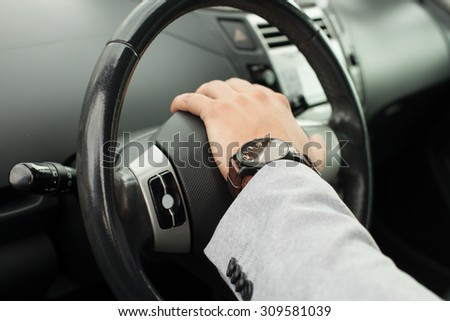 Business man has his hand on the wheel the car #309581039